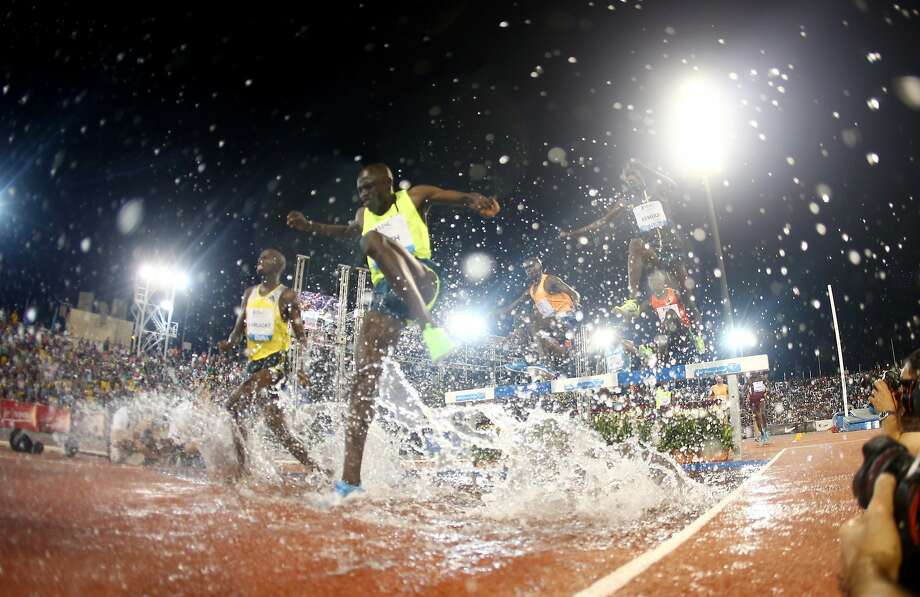 Athletes compete in the men's 3,000m steeplechase at the IAAF Diamond League in the Qatari capital Doha, Friday May 9, 2014. (AP Photo/Osama Faisal) Photo: Osama Faisal, Associated Press