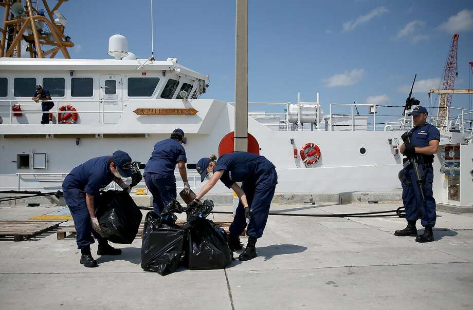 MIAMI BEACH, FL - MAY 09:  U.S. Coast Guard crew members off load bags full of blocks of marijuana as they off load it from the Paul Clark one of the Coast Guard's newest fast-response cutters on May 9, 2014 in Miami Beach, Florida.  The U.S. Coast Guard used two of the new fast-response cutters to seize the more than $3 million in drugs earlier this month on the Caribbean Sea in separate interdictions just a day apart from each other.  (Photo by Joe Raedle/Getty Images) Photo: Joe Raedle, Getty Images
