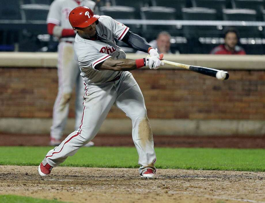 Philadelphia Phillies' Marlon Byrd hits an RBI double during the eleventh inning of a baseball game against the New York Mets, Friday, May 9, 2014, in New York. (AP Photo/Frank Franklin II) ORG XMIT: NYFF112 Photo: Frank Franklin II / AP