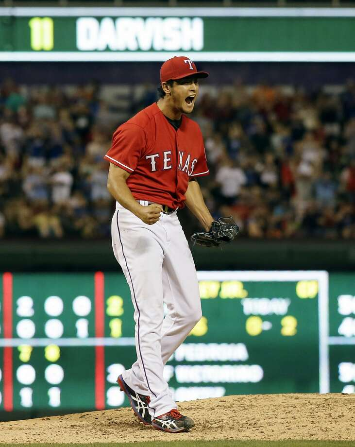 Texas Rangers' Yu Darvish of Japan celebrates after getting the final out of the eighth inning of a baseball game against the Boston Red Sox, Friday, May 9, 2014, in Arlington, Texas. The Japanese ace fell one out shy of a no-hitter for the second time Friday night, giving up only a ninth-inning single to David Ortiz in the Texas Rangers' 8-0 victory over the Boston Red Sox. (AP Photo/Tony Gutierrez) Photo: Tony Gutierrez, Associated Press