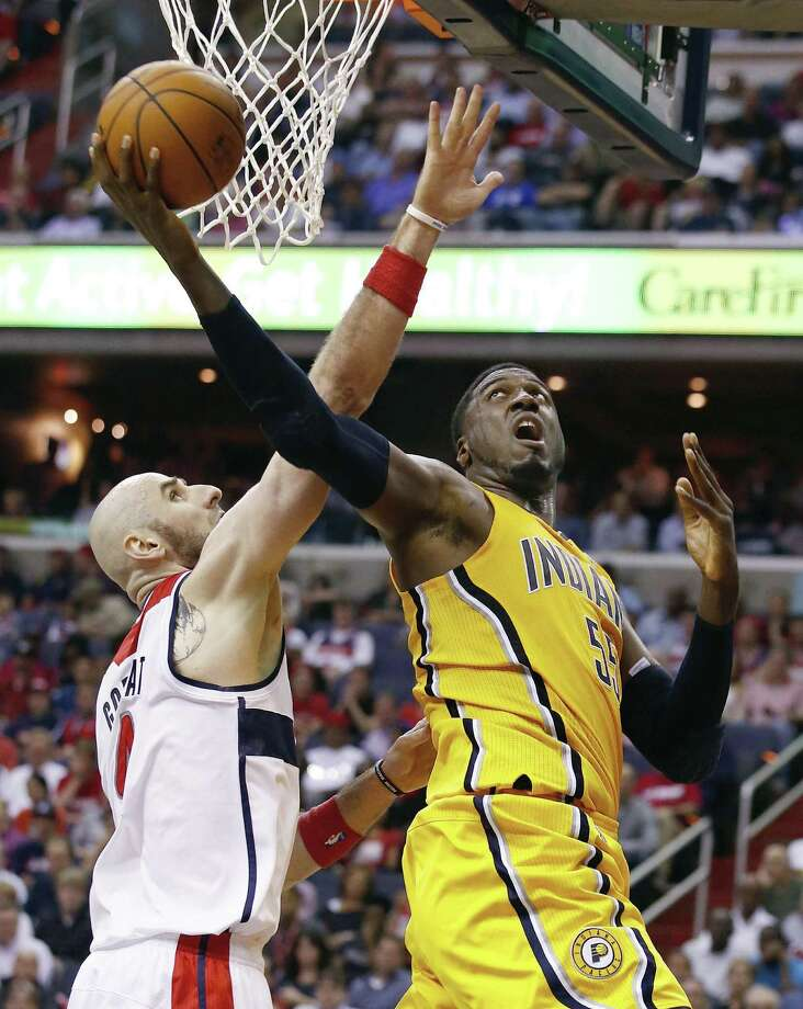 Indiana's Roy Hibbert, who had 14 points and three blocks, puts up a shot vs. Washington's Marcin Gortat. Photo: Alex Brandon / Associated Press / AP