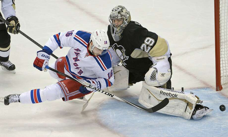 Derick Brassard slips the puck past Pittsburgh goalie Marc-Andre Fleury in the first period of New York's Game 5 victory. Photo: Matt Freed, McClatchy-Tribune News Service