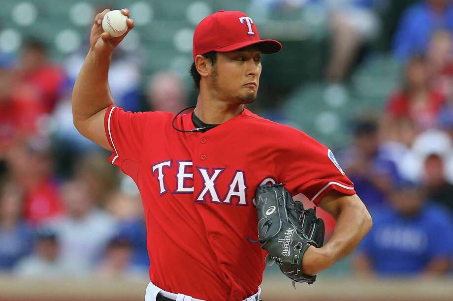 Yu Darvish lost his bid for a no-hitter with two outs in the ninth inning of Texas' victory over Boston. Photo: Ronald Martinez / Getty Images / 2014 Getty Images
