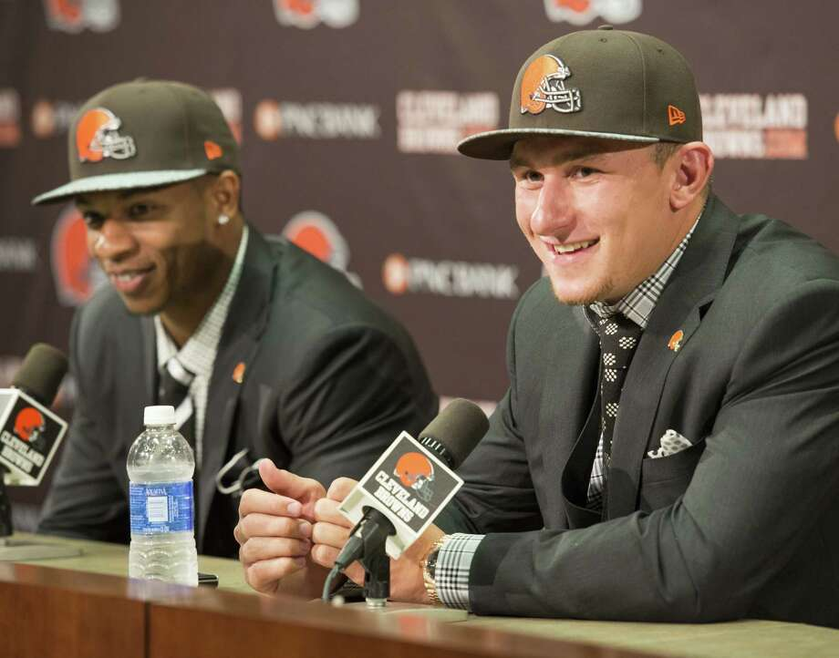 Johnny Manziel (right), with fellow first-round pick Justin Gilbert, has sparked Browns merchandise and season-ticket sales. Photo: Jason Miller / Getty Images / 2014 Getty Images