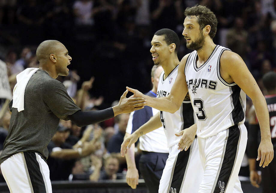 Spurs bench players such as Patty Mills (left) and Marco Belinelli have outscored Portland's bench 100-37 so far. Photo: Edward A. Ornelas / San Antonio Express-News / © 2014 San Antonio Express-News