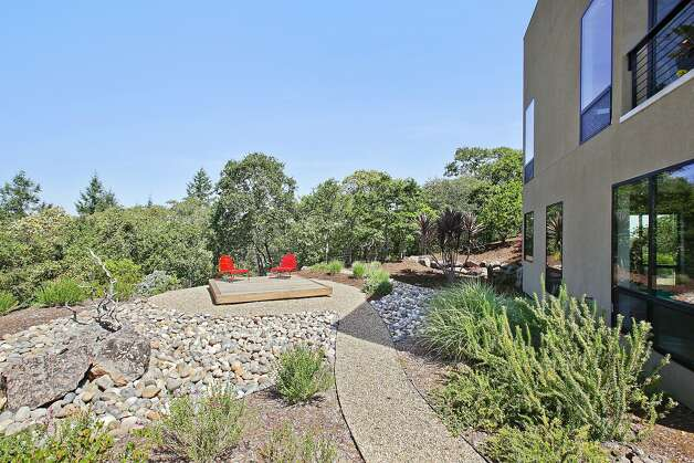 the backyard includes walking paths a yoga deck and an outdoor fire