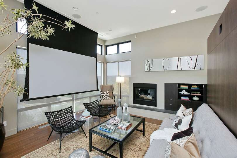 The Home Includes A Projection Screen In Its Living Room Photo