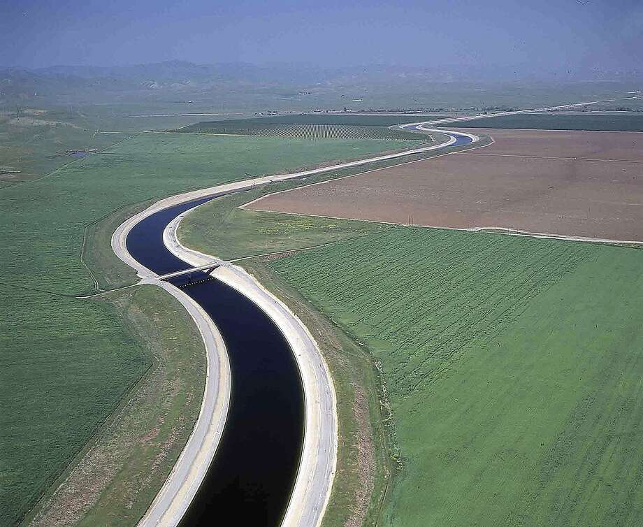 File - This undated file photo released by the California Department of Water Resources shows water making its way south through the Central Valley by way of the California Aqueduct. The California Aqueduct has been ferrying water from the state's verdant north to the south's arid croplands and cities since Gov. Jerry Brown's father was in office half a century ago. But now, amid one of the worst droughts on record, a group of farmers want to route some of that water back uphill. (AP Photo/California Department of Water Resources, Dale Kolke, File) Photo: Dale Kolke, Associated Press
