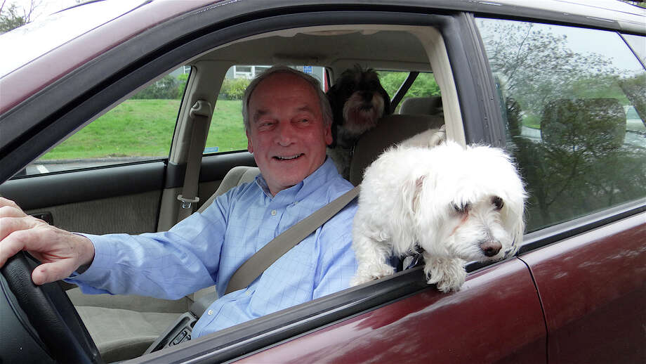 George Klemp, accompanied by his dogs, pulls up to the disposal area at Shred Day on Saturday morning. Photo: Mike Lauterborn / Westport News