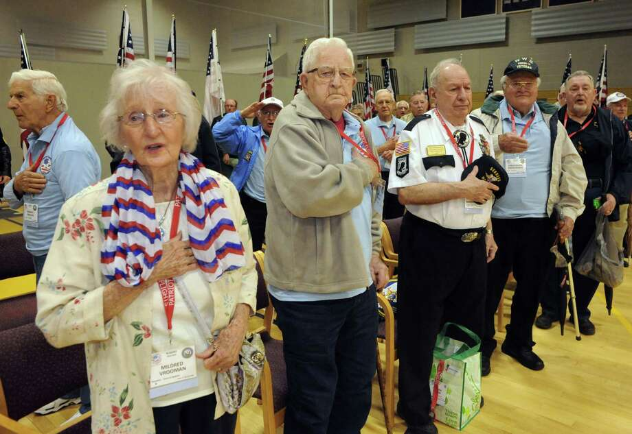 WW II veteran Mildred Vrooman of Saratoga Springs, left, joins other WW II and Korean War veterans in reciting The Pledge of Allegiance during a send off ceremony for veterans flying to Washington D.C. to visit War Memorials Christian Brothers Academy on Saturday May 10, 2014 in Colonie, N.Y. (Michael P. Farrell/Times Union) Photo: Michael P. Farrell / 00026777A