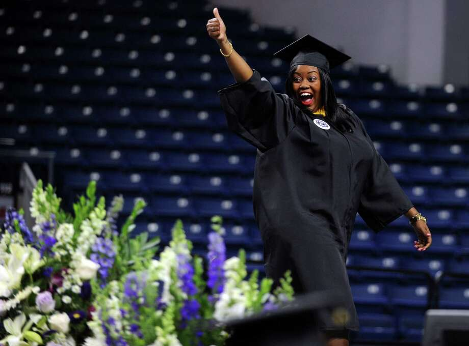 Tamara Salmon, of Bronx, NY, walks across the stage during the University of Bridgeport's 104th Commencement Ceremony Saturday, May 10, 2014, at the Webster Bank Arena in Bridgeport, Conn. Photo: Autumn Driscoll / Connecticut Post