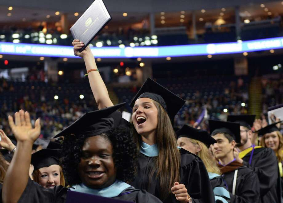 Lauren Silva, of Wolcott, cheers during the University of Bridgeport's 104th Commencement Ceremony Saturday, May 10, 2014, at the Webster Bank Arena in Bridgeport, Conn. Photo: Autumn Driscoll / Connecticut Post