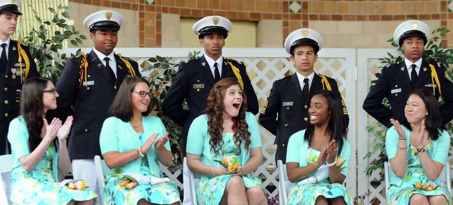 Caitlin Whelan of Albany, center, reacts when she's named the 2014 Tulip Queen during the coronation at the Tulip Festival on Saturday, May 10, 2014, at Washington Park in Albany, N.Y. Joining her, from left is her court, Jillian Callanan, Taramarie Crisafulli, Kasmira Wilkins and Meghan Yi. Cadets from Christian Brothers Academy were the ladies' escorts. (Cindy Schultz / Times Union) Photo: Cindy Schultz / 00026800A