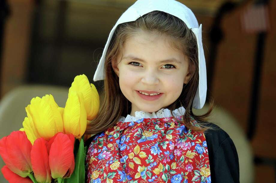 Callista Schermerhorn, 5, of Guilderland with The Dutch Settlers Society of Albany at the Tulip Festival on Saturday, May 10, 2014, at Washington Park in Albany, N.Y. (Cindy Schultz / Times Union) Photo: Cindy Schultz / 00026800A