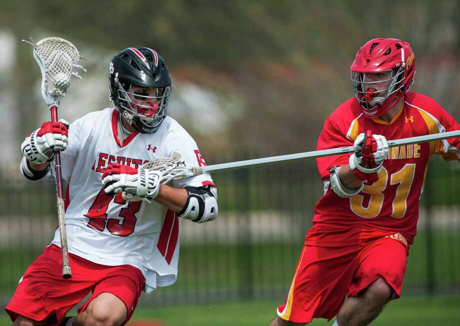 Fairfield Prep's Cameron Harris tries to get by Chaminade high school's Kevin Kelly during a boys lacrosse game played at Fairfield Prep, Fairfield, CT on Saturday, May, 10th, 2014. Photo: Mark Conrad / Connecticut Post Freelance