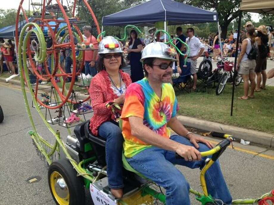 Cars, crowds, trucks and weird contraptions converged on Allen Parkway for the 27th annual Houston Art Car Parade on May 10, 2014. Photo: Heather Alexander, Houston Chronicle