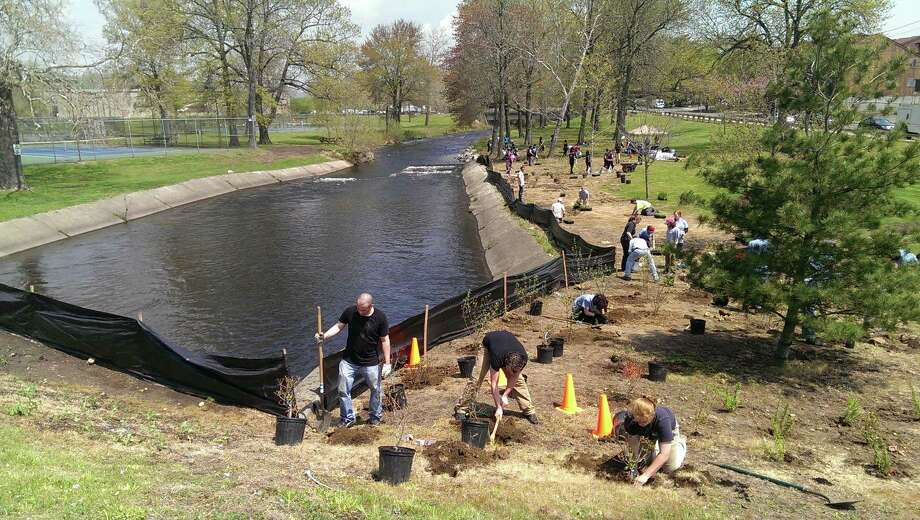 On Saturday, May 10, 2014 volunteers finished work on a fish passage on the Pequonnock River in Bridgeport. Volunteers planted native plants along the river to filter runoff from roads and provide a habitat for wildlife. Photo: Fausto Giovanny Pinto, Connecticut Post / Connecticut Post