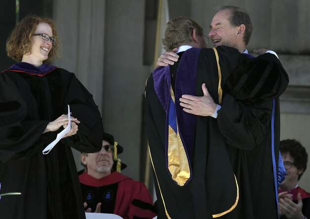 Acting Dean Gillian Lester cheers as litigators Ted Olson (center) and David Boies hug after delivering their keynote addresses to about 400 graduates and their families at the UC Berkeley School of Law. The former adversaries are now good friends. Photo: Paul Chinn, The Chronicle