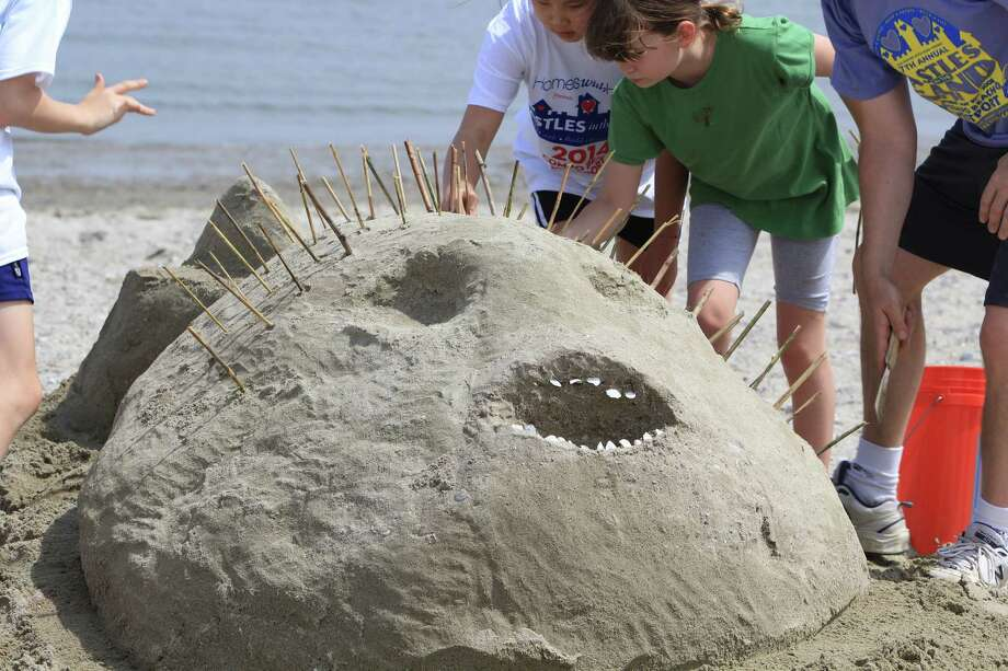 Westport's annual Castles in the Sand event was held at Compo Beach on May 10. Participants built sand creations to benefit Homes With Hope, a non-profit organization that provides homes for the homeless, women and children leaving domestic violence and others. Were you SEEN at Castles in the Sand? Photo: Derek T.Sterling, Derek Sterling/Hearst Connecticut Media Group