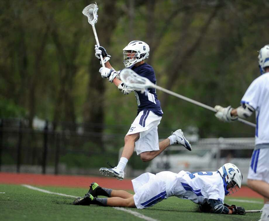 Staples' Tucker Bobrow takes a shot during their lacrosse match against Fairfield Ludlowe High School Saturday, May 10, 2014, at Taft Field in Fairfield, Conn. Photo: Autumn Driscoll / Connecticut Post