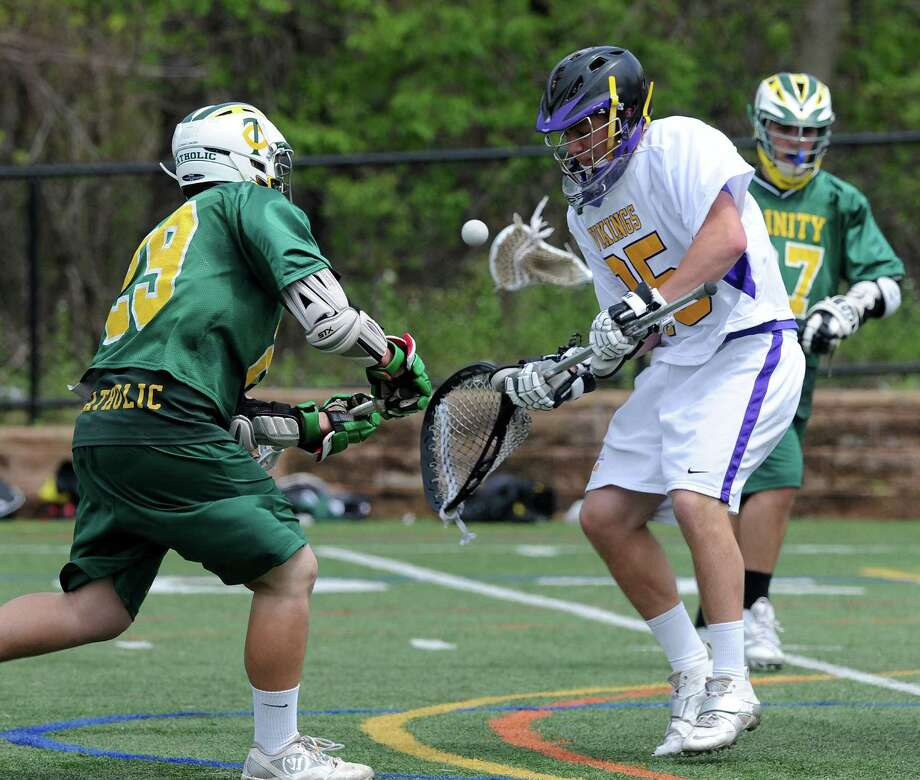 Trinity Catholic's Drew Scanlan takes a shot that is blocked by Westhill goalie Tom Thibault during Saturday's boys lacrosse game at Westhill High School on May 10, 2014. Photo: Lindsay Perry / Stamford Advocate