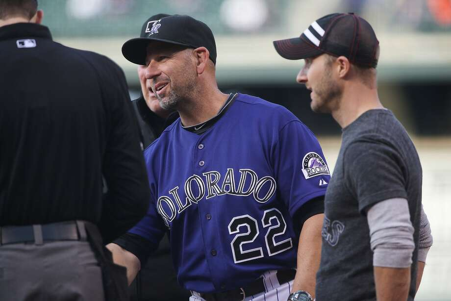 Walt Weiss (22), in his first managerial job with the Rockies, has them in second place in the NL West. Photo: David Zalubowski, Associated Press