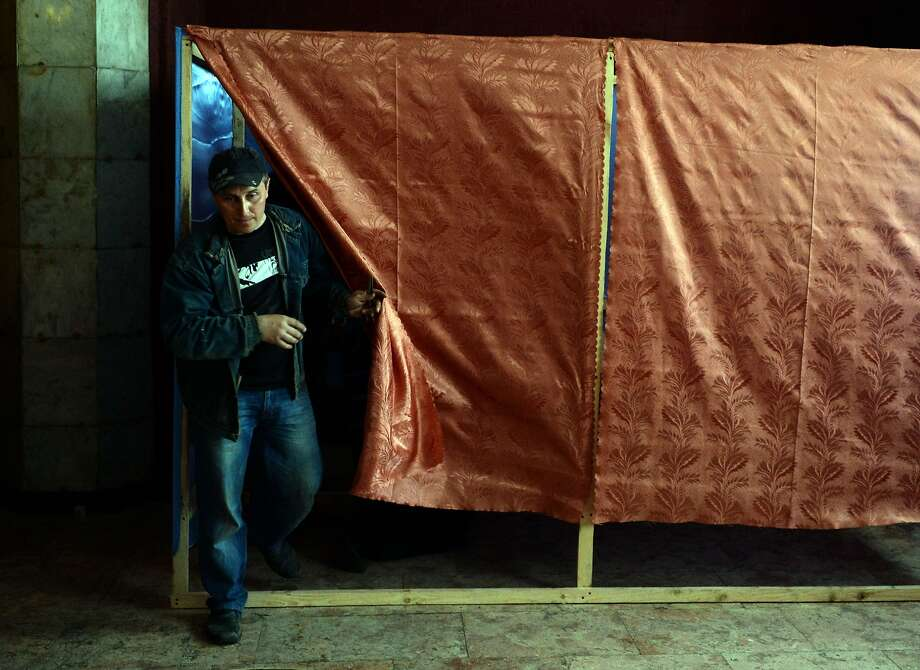 Workers prepare a voting booth in Slavyansk, Ukraine, for a disputed referendum. Photo: Vasily Maximov, AFP/Getty Images
