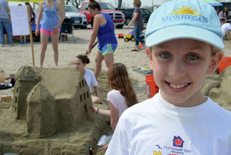 Eliza Barr, 10, of Westport, a veteran of the Castles in the Sand event, worked Saturday with friends to make a replica of the histroric Kemper-Gunn House downtown, the subject of many months of debate over its proposed relocation. The annual Compo Beach event benefits Homes with Hope. Photo: Jarret Liotta / Westport News