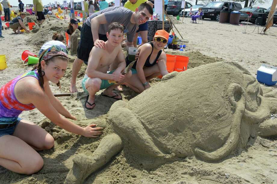 "Four friends made Audrey II from ""Little Shop of Horrors"" on Saturday at Castles in the Sand -- from left, Grace Olsen of Westport, David Kalvfleisch of Boston, Mass., James Pouliot (standing) of Newburyport, Mass., and Margot Bruce of Westport. Photo: Jarret Liotta / Westport News"