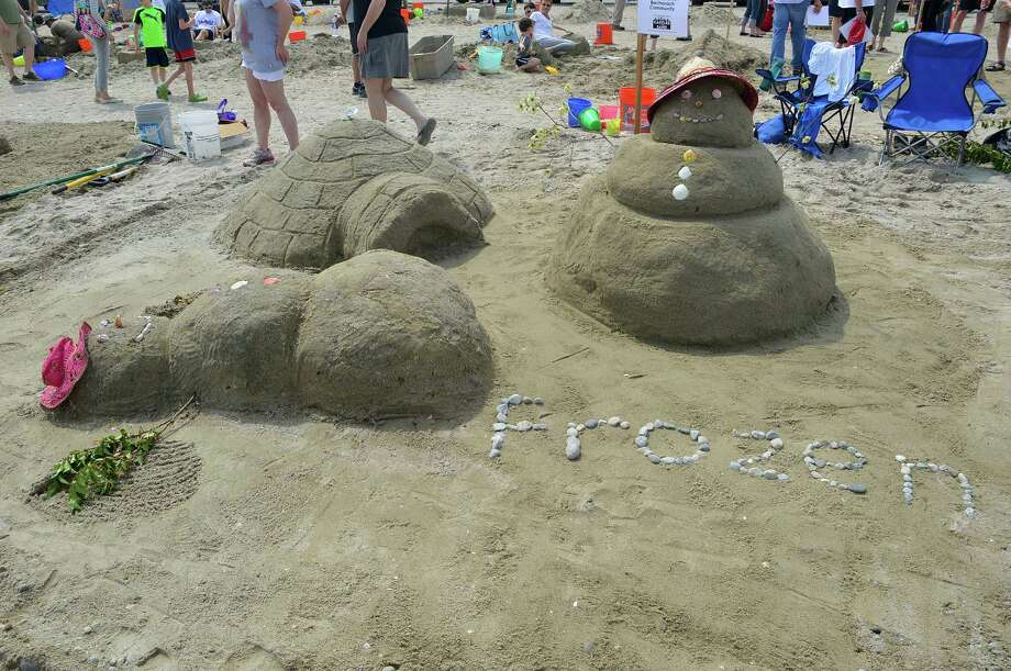 "This sandcastle at Compo Beach on Saturday was inspired by the popular move, ""Frozen."" Photo: Jarret Liotta / Westport News"