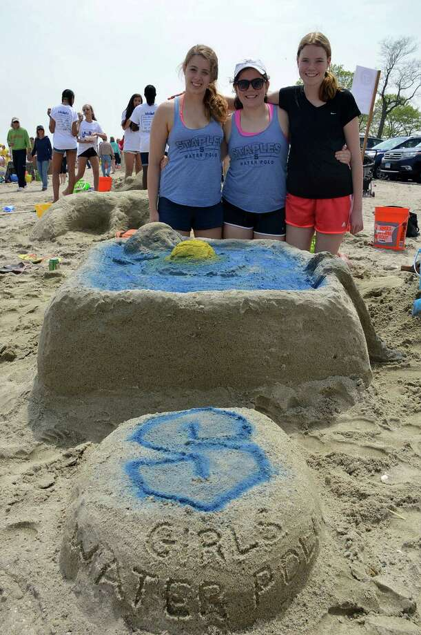The sandcastle of polo players in a pool was created Saturday by members of the Staples High School water polo team, including, from left, Julia Woods, 17, team captain; Caroline Gray, 14, and Hope Penwell, 14, all of Westport. Photo: Jarret Liotta / Westport News