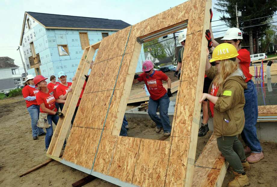 Nearly 30 volunteers begin building a home for local family in recognition of National Women Build Week on Saturday May 10, 2014 in Schenectady, N.Y. (Michael P. Farrell/Times Union) Photo: Michael P. Farrell / 00026854A