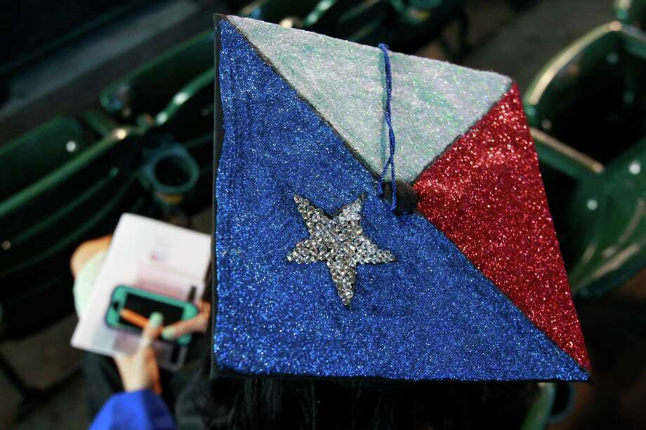 Robin Lee Cadena of Houston and a social science major is shown in her Texan decorated graduation cap as she and other University of Houston Downtown students wait to begin commencement ceremony at Minute Maid Park Saturday, May 10, 2014, in Houston. Photo: Melissa Phillip, Houston Chronicle / © 2014  Houston Chronicle
