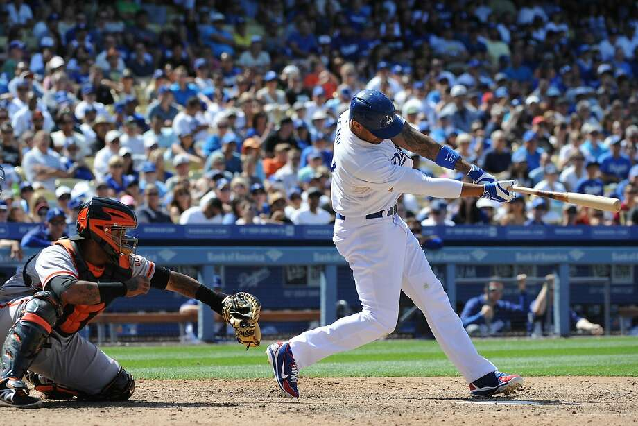 Matt Kemp #27 of the Los Angeles Dodgers hits a RBI single in the sixth inning against the San Francisco Giants at Dodger Stadium on May 10, 2014 in Los Angeles, California. Photo: Lisa Blumenfeld, Getty Images