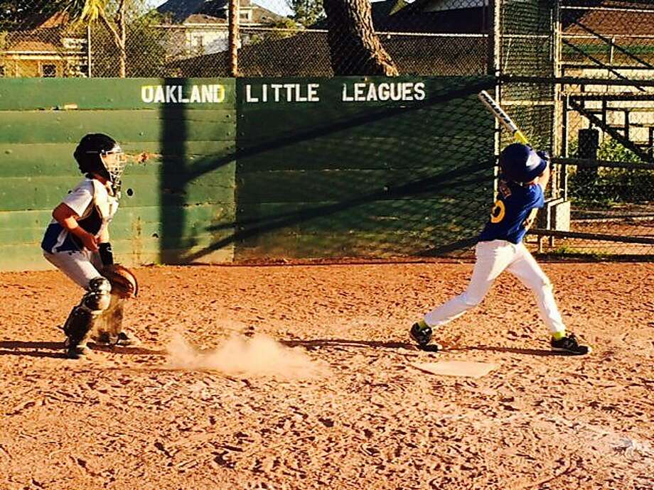 Oakland Little League players practice at Bushrod Park, which was to benefit from a fundraiser featuring the A's. Photo: Andrew Ross, The Chronicle