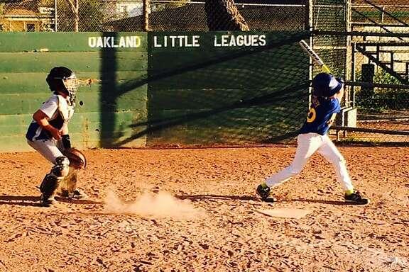 Little League players practice at Oakland's Bushrod Park.