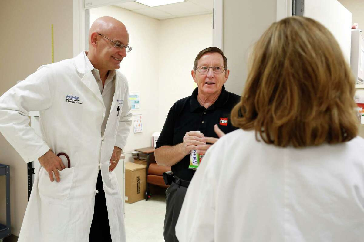 Baylor's Dr. Christie Ballan-tyne, left, with cholesterol study patient Jack Manley, says drug company relation-ships are important to patient care.