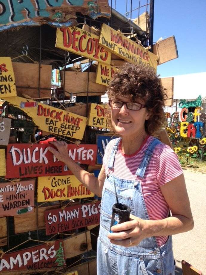 'Dollar Debbie' has been selling hand-painted signs at First Monday since 1988. The Canton event is billed as the nation's largest flea market. Photo: Joe Holley, Staff / © 2013 Houston Chronicle