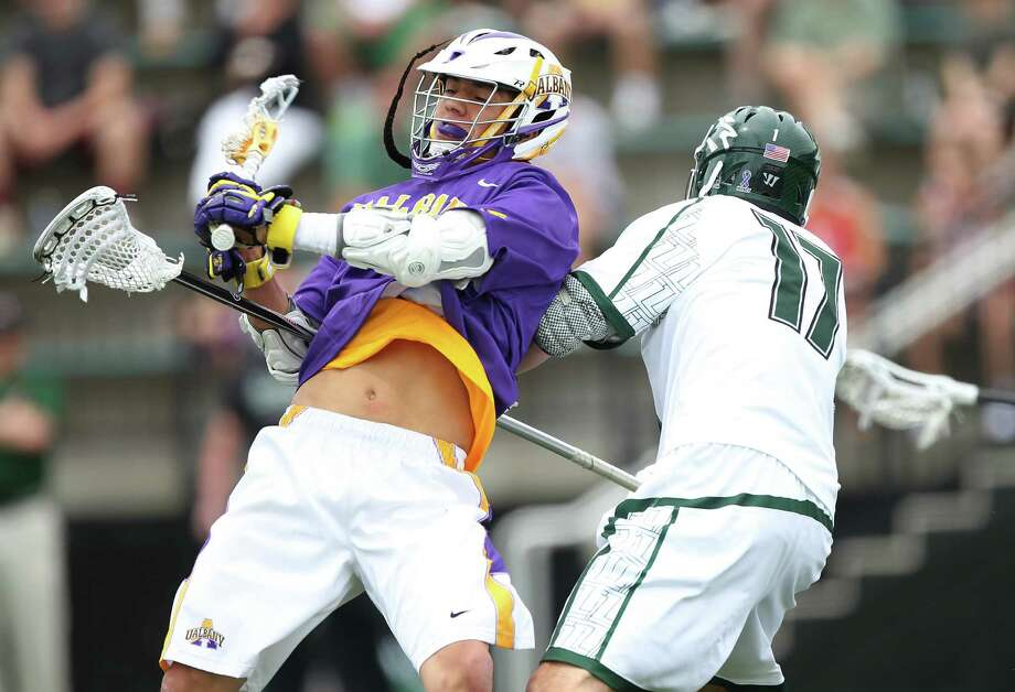 UAlbany attack Lyle Thompson, left, scores past Joe Fletcher of Loyola in the first round of the men's lacrosse NCAA Tournament at Ridley Athletic Complex in Baltimore. (Brian Schneider / www.ebrianschneider.com) Photo: Brian Schneider / Brian Schneider
