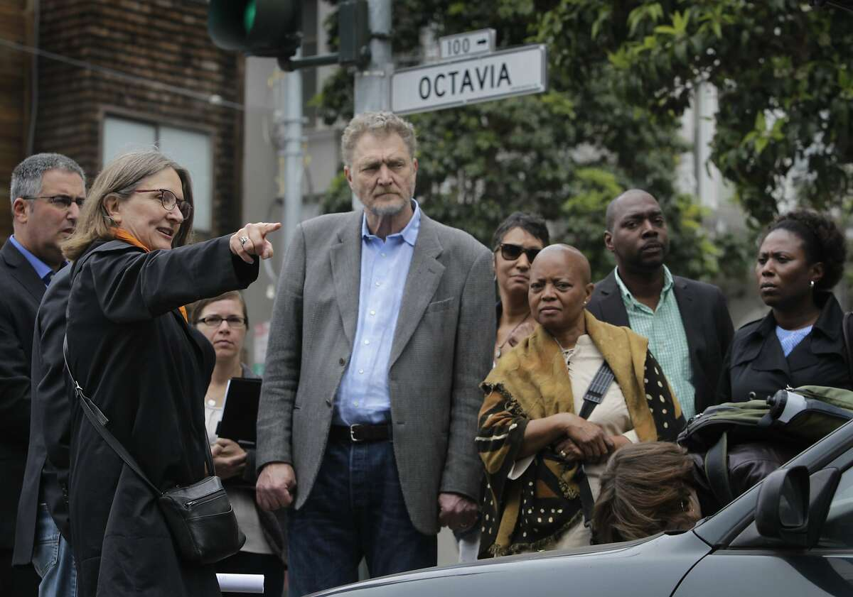 Urban designer Elizabeth Macdonald (left) leads representatives from New Orleans and Syracuse, N.Y. on a walking tour of the Octavia Boulevard expressway corridor in San Francisco, Calif. on Thursday, May 8, 2014. Both cities are considering similar development to elevated freeways in their region.