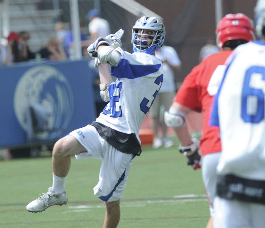 Boys high school lacrosse match between Darien High School and Greenwich High School at Darien, Saturday afternoon, May 10, 2014. Darien remained undefeated, winning the match over Greenwich, 10-4. Photo: Bob Luckey / Greenwich Time