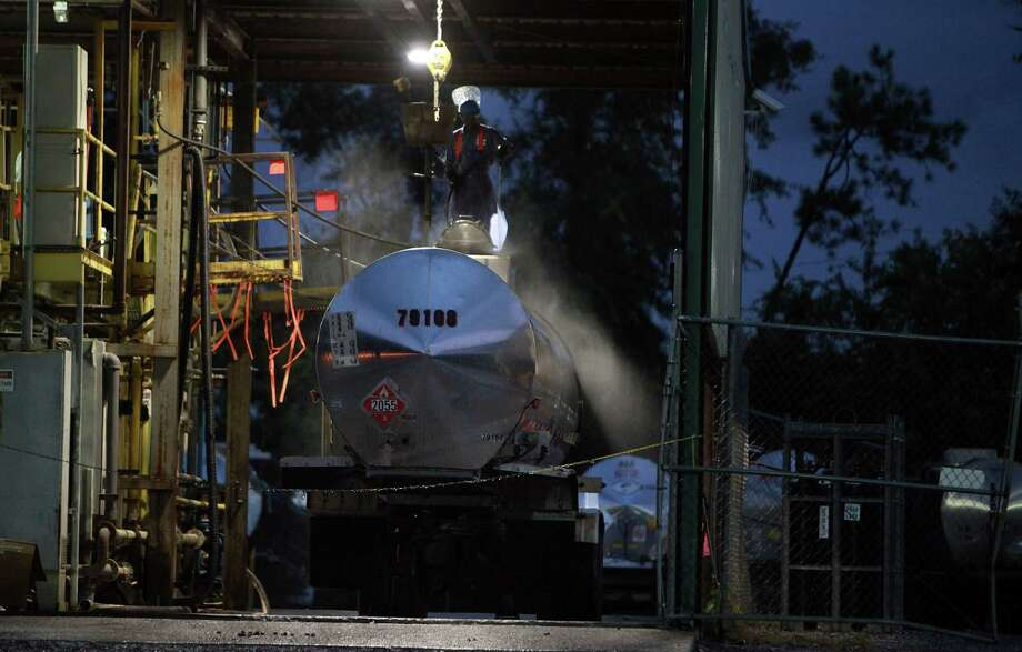 Steam pours from a tank trailer at a wash site in Alabama. A sign indicates the truck held styrene monomer, a plastics component.
