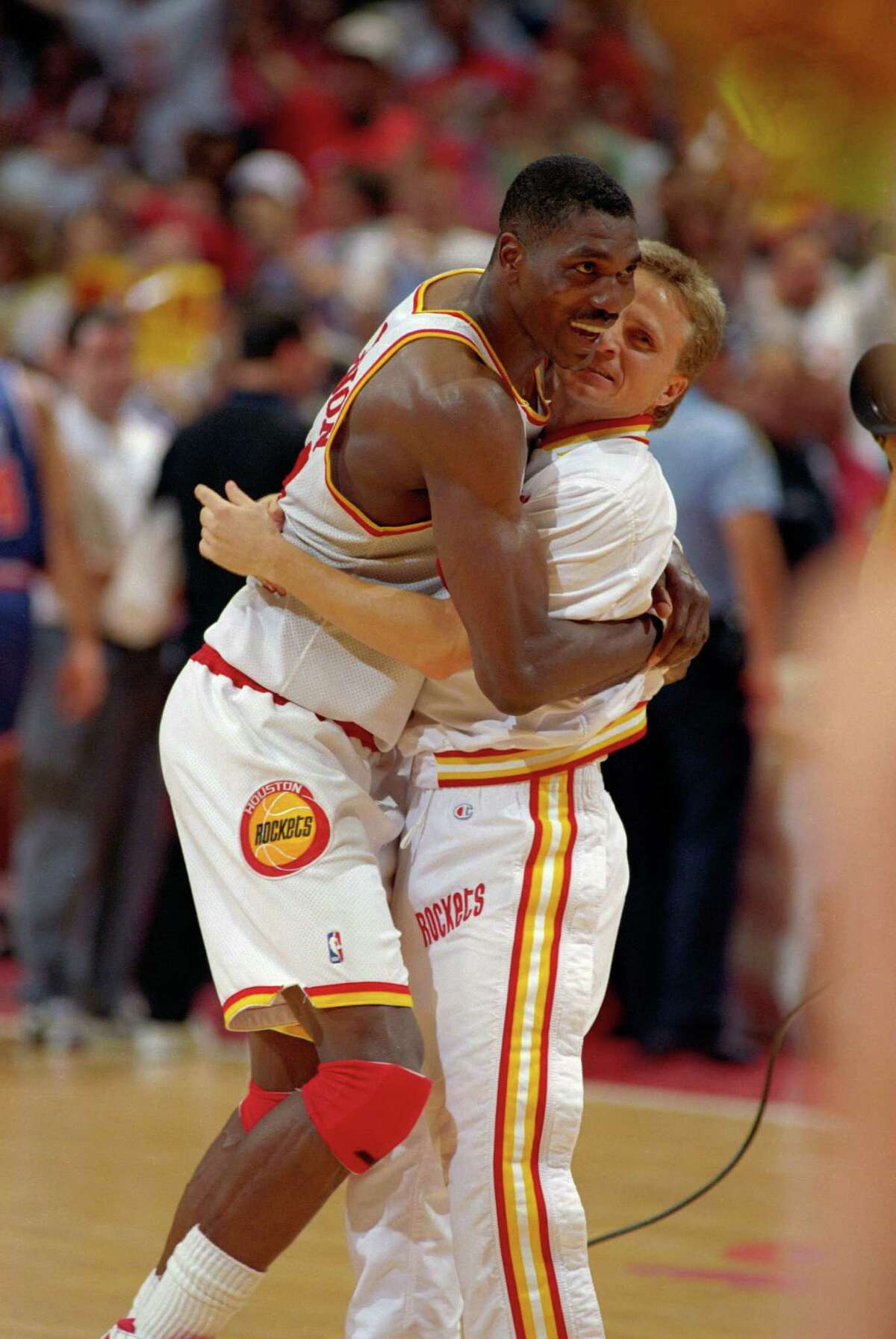 Hakeem Olajuwon and teammate Scott Brooks celebrate after the Rockets won the NBA title on June 22, 1994, rising from the depths of Choke City in Game 3 to winning Game 7 and providing Houston with is first major sports championship.