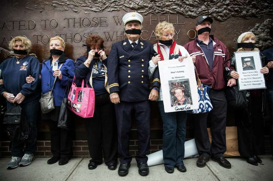 Relatives of firefighter Christopher Santora, who was killed in the 2001 terror attacks, protest having unidentified remains at the site of the 9/11 museum in New York. Photo: Andrew Burton / Getty Images / 2014 Getty Images