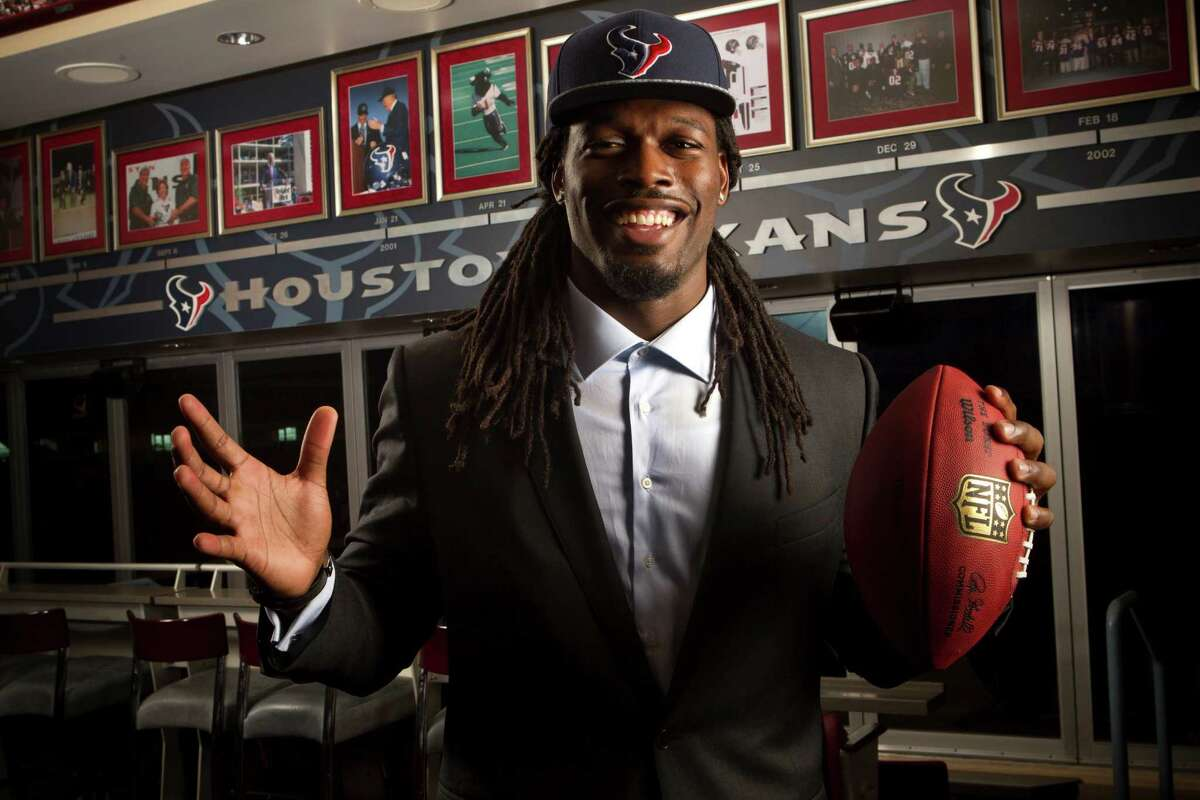 The charismatic Jadeveon Clowney casts an almost larger-than-life presence at NRG Stadium after becoming the Texans' No. 1 pick.