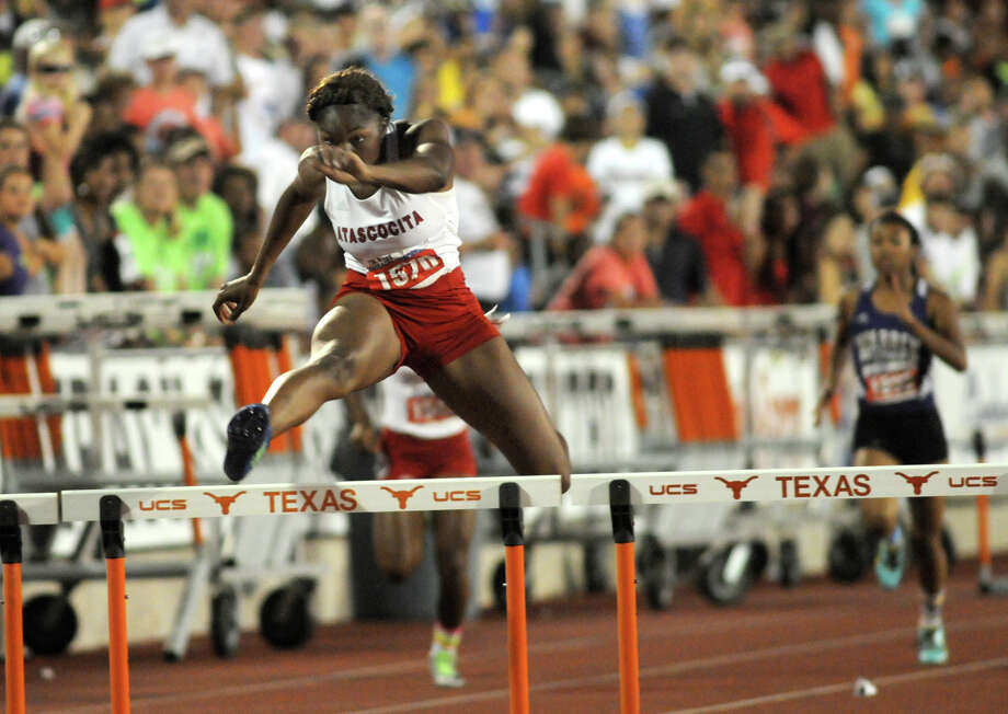 Atascocita senior Ariel Jones pushes to the finish line in the Class 5A Girls 300 Meter Hurdles during the UIL State Track & Field Championships at Mike A. Myers Stadium in Austin on Saturday. Photo: Jerry Baker, For The Chronicle