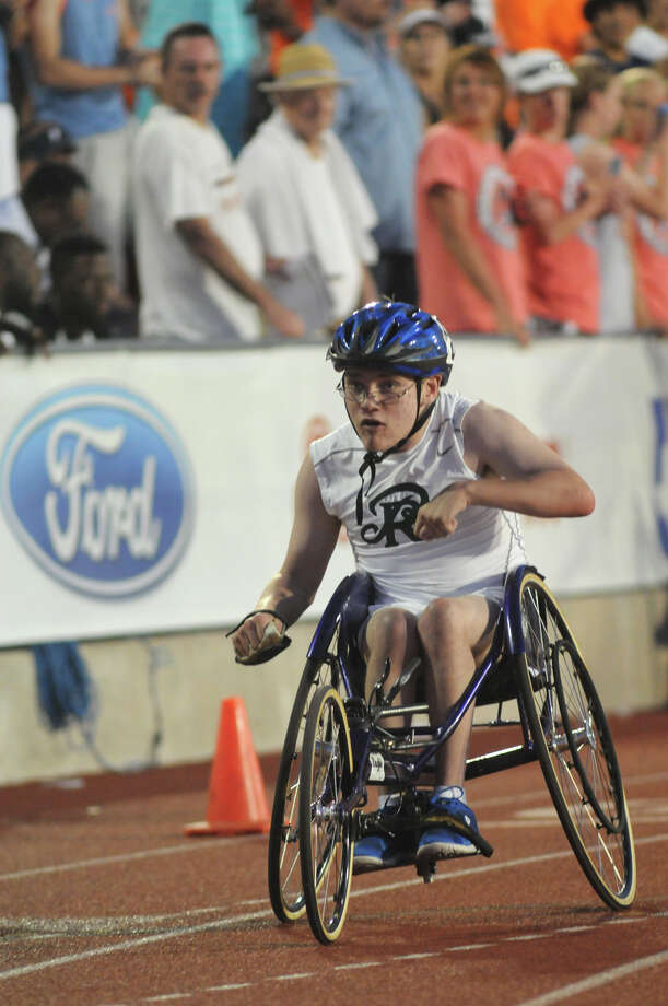 San Antonio Reagan's Wyatt Stuckness pushes to the finish line in the Boys 400 Meter Dash Wheelchair event during the UIL State Track & Field Championships at Mike A. Myers Stadium in Austin on Saturday. Photo: Jerry Baker, For The Chronicle