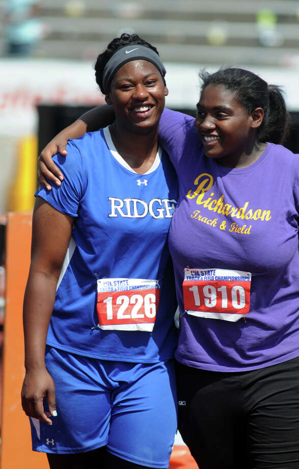 Oak Ridge senior N'Dia Warren-Jaques, left, shares a hug with fellow shot-putter Asia Abron, a sophomore from Richardson High School, after Warren-Jaques won the Class 5A Girls Shot Put during the UIL State Track & Field Championships at Mike A. Meyers Stadium in Austin on Saturday. Photo: Jerry Baker, For The Chronicle
