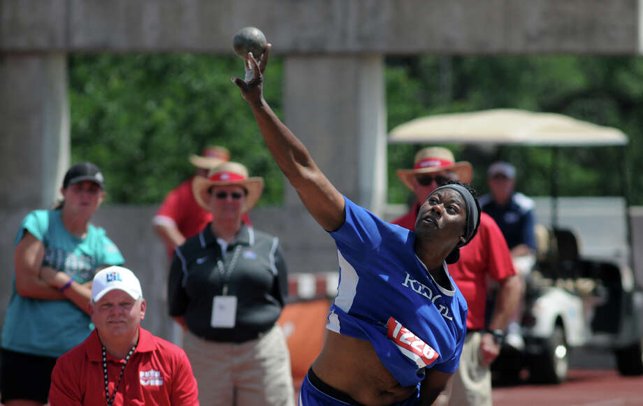 Oak senior N'Dia Warren-Jaques makes her winning throw in the Class 5A Girls Shot Put competition during the UIL State Track & Field Championships at Mike A. Meyers Stadium in Austin on Saturday. Photo: Jerry Baker, For The Chronicle