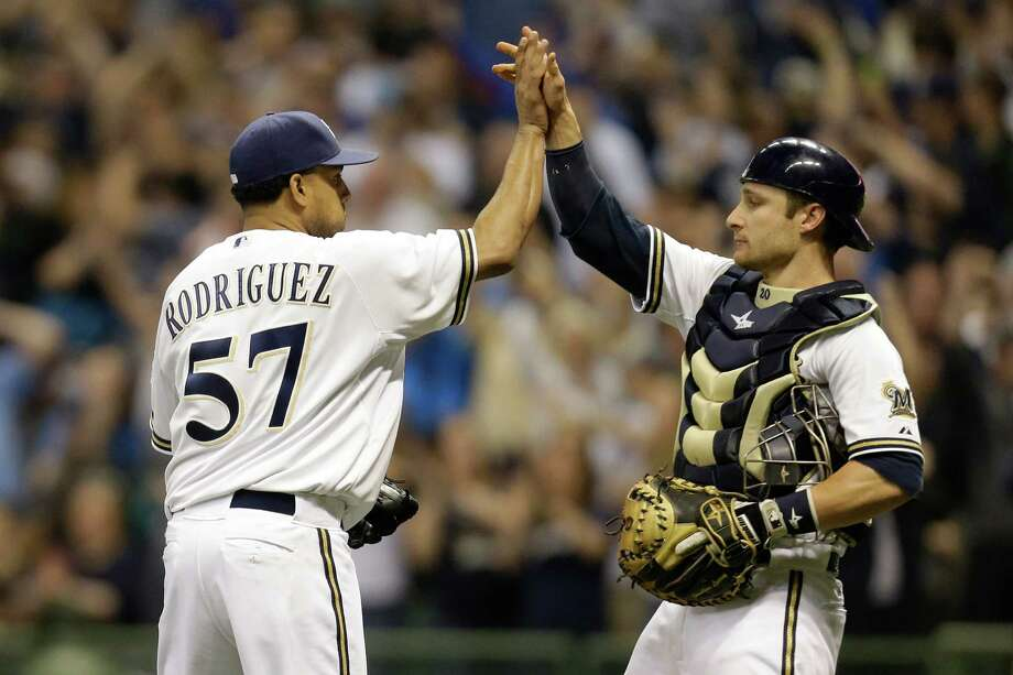 MILWAUKEE, WI - MAY 10: Francisco Rodriguez #57 of the Milwaukee Brewers celebrates with Jonathan Lucroy #20 after the 5-4 win over the New York Yankees during the Interleague game at Miller Park on May 10, 2014 in Milwaukee, Wisconsin. (Photo by Mike McGinnis/Getty Images) ORG XMIT: 477583065 Photo: Mike McGinnis / 2014 Getty Images